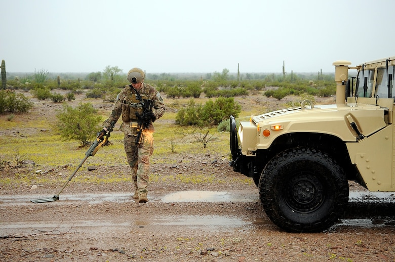 Staff Sgt. Steven Dauck, 56th CES EOD team leader, sweeps for a secondary explosive device Oct. 8 in front of a high-mobility multi-wheeled vehicle to ensure the road is clear of pressure plate improvised explosive devices. (U.S. Air Force photo/Airman 1st Class Pedro Mota)
