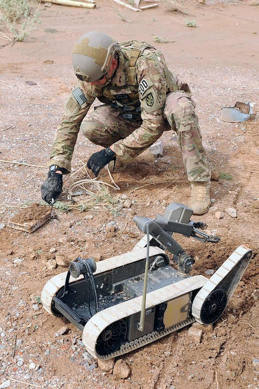 Staff Sgt. Steven Dauck, 56th CES EOD team leader, unhooks a rope from a pressure plate IED Oct. 8 after a remote-remove procedure was completed. Dauck collected the pressure plate portion of the IED for evidence to attack the IED network. (U.S. Air Force photo/Airman 1st Class Pedro Mota)