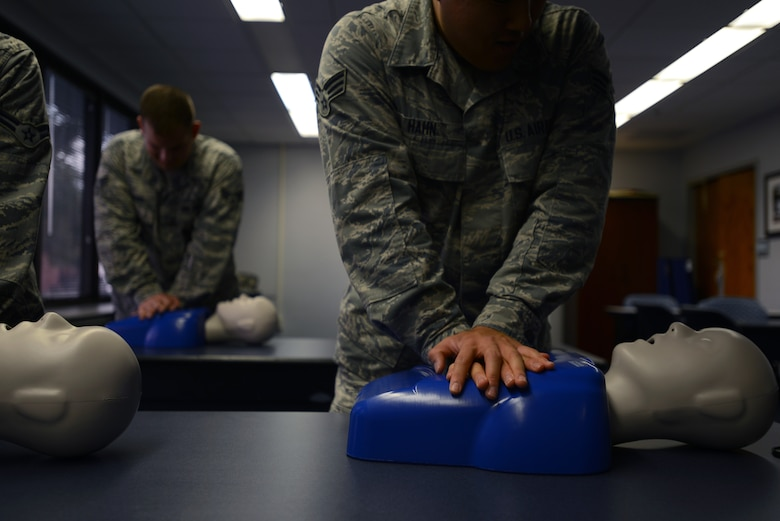 Senior Airman Samuel Hahn, 47th Medical Group Public Health technician, completes chest compressions on a training mannequin at the 47th Medical Group training classroom Oct. 23, 2014. About 92 percent of sudden cardiac arrest victims die before reaching the hospital, but statistics prove that if more people knew cardiopulmonary resuscitation, more lives could be saved. Immediate CPR can double, or even triple, a victim's chance of survival. (U.S. Air Force photo by Staff Sgt. Steven R. Doty)(Released)