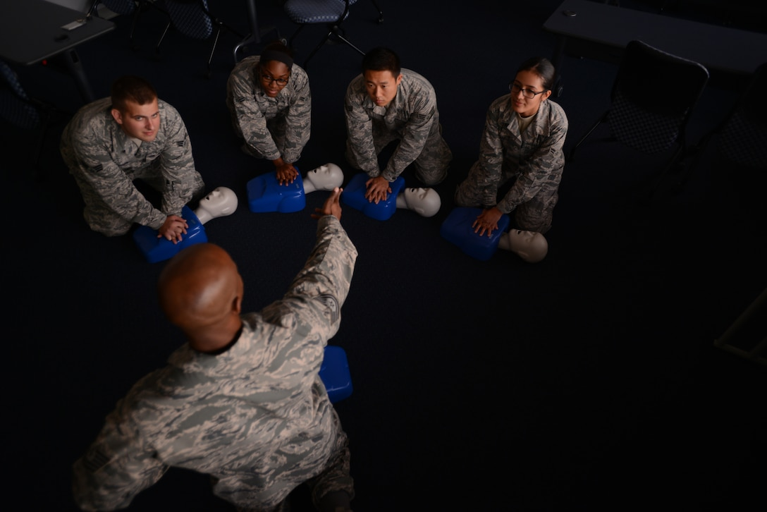 Tech. Sgt. Robert Niter, 47th Medical Group NCO in charge of optometry, instructs medical personnel at the 47th Medical Group training classroom Oct. 23, 2014. On Sept. 12, 2013, Niter performed cardiopulmonary resuscitation for over 25 minutes to save a man's life in Houston, Texas.  He was later honored as a hero of Houston by its mayor and commended by his leadership.  (U.S. Air Force photo by Staff Sgt. Steven R. Doty)(Released)