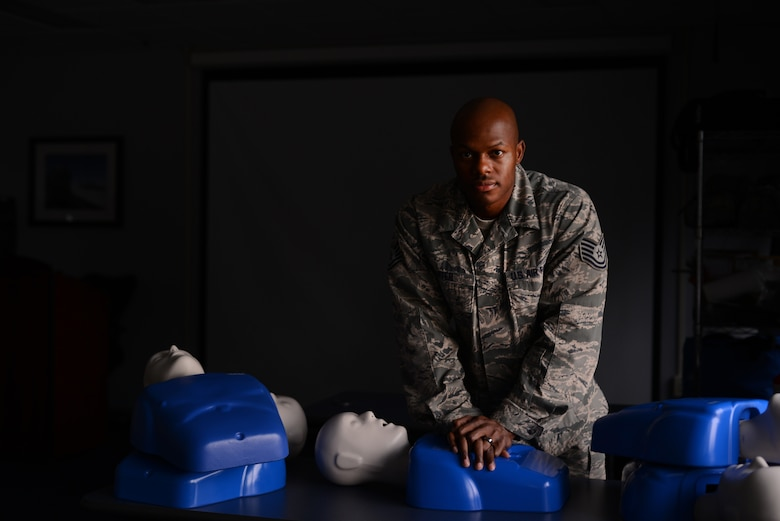Tech. Sgt. Robert Niter, 47th Medical Group NCO in charge of optometry, poses for a portrait at the 47th Medical Group training classroom Oct. 23, 2014. Niter is the Basic Life Support program director for the 47th Flying Training Wing and is responsible for training individuals requiring cardiopulmonary resuscitation certification. (U.S. Air Force photo by Staff Sgt. Steven R. Doty)(Released)