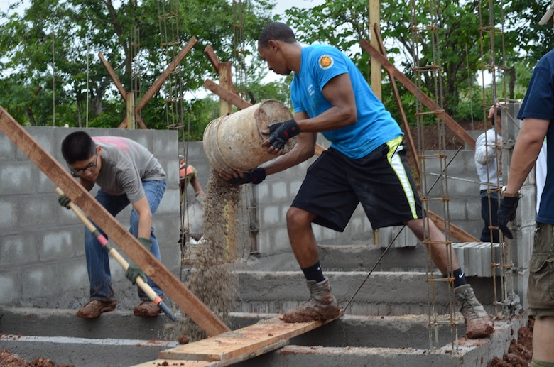 Twenty-seven volunteers from Joint Task Force- Bravo help carry cement blocks and shovel dirt for the foundation of 10 homes during a Habitat for Humanity build in La Paz, Honduras, Oct. 18, 2014.   The homes are the first of 20 homes that will eventually be built in the new La Paz site, and they are expected to be completed by Dec. 20, 2014.  Founded in 1976, Habitat for Humanity is a nonprofit, ecumenical Christian ministry dedicated to building and repairing homes with those in need.  Habitat for Humanity's work began in Honduras in 1988 and over the years, reached more than 70 communities and served over 15,240 families. (U.S. Air Force Photo/Capt. Connie Dillon)