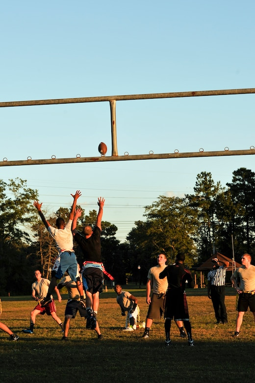 The 437th Aircraft Maintenance Squadron scores a field goal during an intramural flag football game Oct 21, 2014, at Joint Base Charleston, S.C. The 628th Civil Engineer Squadron defeated AMXS 24 - 14. (U.S. Air Force photo/Staff Sgt. Renae Pittman)