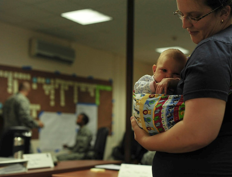 Miriam Grunert, wife of Capt. Jeremy Grunert, 39th Air Base Wing Legal office chief of legal services, holds her newborn daughter, Tzipora Grunert during an Air Force Smart Operations of the 21st century event on the stork nesting program Oct. 23, 2014, Incirlik Air Base, Turkey. Grunert was a member of the AFSO21 program to provide first-hand information on the stork nesting process. (U.S. Air Force photo by Staff Sgt. Eboni Reams/Released)