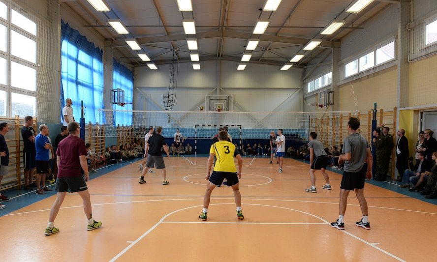 U.S. Air Force Airmen assigned to the 182nd Airlift Wing, Illinois Air National Guard, Peoria, Ill., and Detachment 1, 52nd Operations Group, from Lask Air Base, Poland,, play volleyball against students from Zespol Szkol Ponadgimnazjalnych W Kleczewie, a Polish high school, during a school visit Oct. 21, 2014, at the school in Kleczewie, Poland. Airmen played a game against the school team before mixing teams and playing another game during the visit. The 182nd AW is supporting rotation 15-1 hosted by the Aviation Detachment. The rotation serves as part of a bilateral training with Poland to maintain joint readiness, build interoperability and reassure allies and partners. (U.S. Air Force photo by Airman 1st Class Dylan Nuckolls/Released)