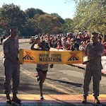 Army Spec. Samuel Kosgei as he crosses the finish line to win the 39th Marine Corps Marathon.
