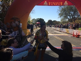 Army Capt. Meghan Curran after crossing the finish line, winning the 39th Marine Corps Marathon Women's Title.