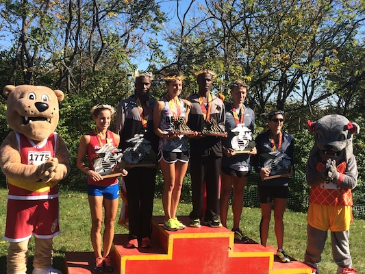 The top finishers of the 39th Marine Corps Marathon. Armed Forces athletes took five of the six spots on the podium, with Army Capt Meghan Curran and Army Spec. Samuel Kosgei winning the Women's and Men's Division.