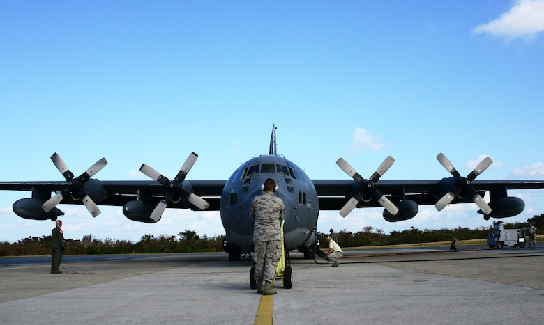 A MC-130P Combat Shadow crew and maintainers prepare to start engines before conducting a 4-ship formation flight Oct. 16, 2014 at Kadena Air Base, Japan.  The formation flight marks the beginning of the retirement for the Combat Shadow in the Pacific, as the unit transitions to the MC-130J Commando II.  (U.S. Air Force photo by Tech. Sgt. Kristine Dreyer)