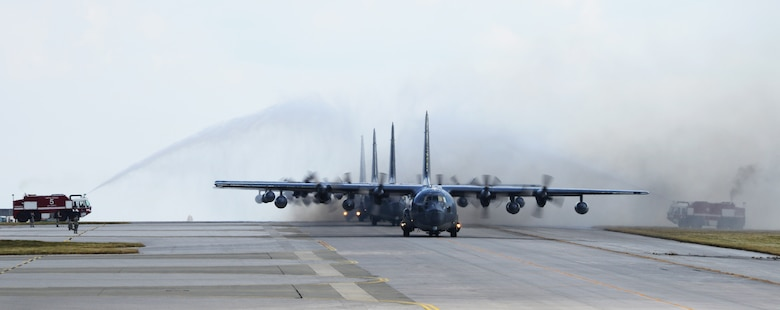 Four MC-130P Combat Shadows taxi through the water arch after completing a final 4-ship formation flight Oct. 16, 2014.  Over the next year, the MC-130P Combat Shadow aircraft in the Pacific will be replaced with the MC-130J Commando II.  (U.S. Air Force photo by Tech. Sgt. Kristine Dreyer)