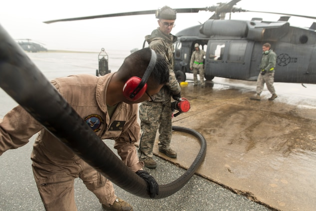 Cpl. Eduardo Bahena, a semitrailer refueler operator with Marine Wing Support Squadron 171, refuels an HH-60G Pave Hawk with the help of airmen during the Korean Marine Exchange Program 14-13, Oct. 20, 2014, on Osan Air Base, Republic of Korea. The program's goals are to increase the combat readiness of Marine Aircraft Group 12, improve its operating skills as a Marine Air-Ground Task Force and enhance joint and combined integration with the U.S. Air Force and ROK Marine Corps. KMEP 14-13 is a multinational exercise that focuses on the integration of aviation and ground assets within the construct of a traditional Combined Arms Live Fire Exercise. Supporting assets include, but are not limited to, Marine Aviation Logistics Squadron 12 and MWSS-171.
