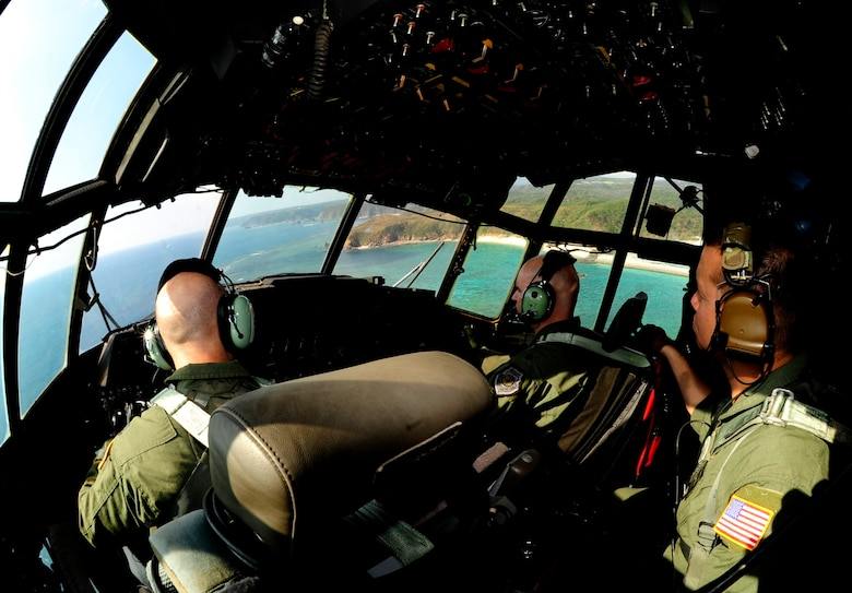 Members from 17th Special Operations Squadron fly an MC-130P Combat Shadow around the coast of Okinawa, Japan, Oct. 16, 2014 during a four-ship formation. All Pacific-based MC-130P Combat Shadow aircraft will be retired over the next year and replaced with the MC-130J Commando II. The flight marked the last time the Combat Shadows will conduct a four-ship formation at Kadena. (U.S. Air Force photo by Airman 1st Class Keith James)