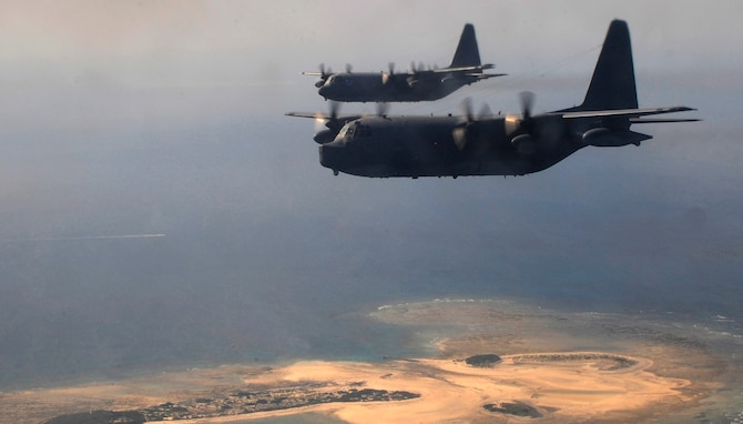 Two MC-130P Combat Shadows assigned to the 17th Special Operations Squadron fly Oct. 16, 2014, over the coast of Okinawa, Japan. The MC-130P conducts single or multi-ship infiltration, exfiltration and resupply of special operations forces. (U.S. Air Force photo/Airman 1st Class Keith James)