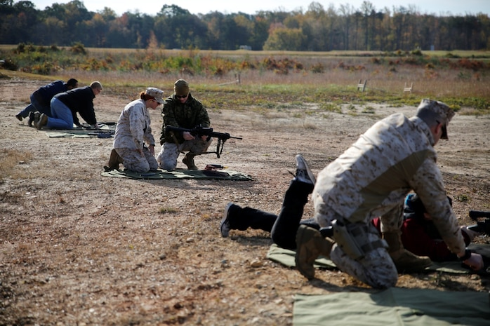 Members of the infantry weapons systems program management office from Marine Corps Systems Command spent a day at a live-fire range getting familiar with the gear they procure and field for Marines in the Fleet. The range day was held Oct. 24 aboard Marine Corps Base Quantico.
