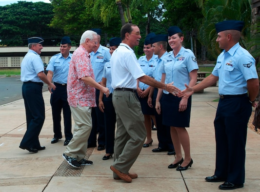 Air Force Chief of Staff Gen. Mark A. Welsh III, far left, and members of the Air Force Civic Leader Program greet Airmen assigned to Joint Base Pearl Harbor-Hickam, Oct. 14, 2014. At the invitation of Welsh, and hosted by Pacific Air Forces, the civic leaders spent three days visiting military installations and units to gain a hands-on understanding of the missions and capabilities of the Air Force, Army, Marine Corps, Navy and Coast Guard, and their respective contributions to the Pacific Rebalance. (U.S. Air Force photo/Tech. Sgt. Lucelia Ball)