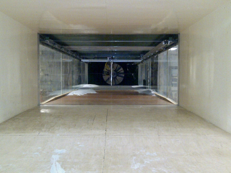 The Environmental Wind Tunnel located at ERDC-CRREL is 2.4 m wide by 1.2 m tall and can achieve air-flow velocities up to 11 m/s. The test section is 9.8m long.