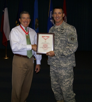 Tulsa District Commander, Col. Richard A. Pratt, presents the Bronze De Fleury medal to Stephen L. Nolen, chief of Natural Resources and Recreation Branch. Nolen has provided 30 years of outstanding service to the U.S. Army Corps of Engineers.