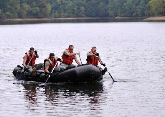 DIA service members participate in the Prince George's County Police Fifth Annual Iron Team Competition where teams of four endure 16 grueling, consecutive events in a timed race. Photos by Navy Lt. Jeff Prunera, DIA