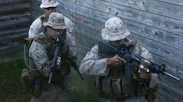 Marines with 2nd Battalion, 6th Marine Regiment, 2nd Marine Division, II Marine Expeditionary Force practice clearing rooms during a training exercise at MOC-3 range aboard Marine Corps Base Camp Lejeune, N.C., Oct. 21, 2014. The Marines conducted the Military Operations on Urban Terrain training with live rounds and live grenades to expand their level of readiness.