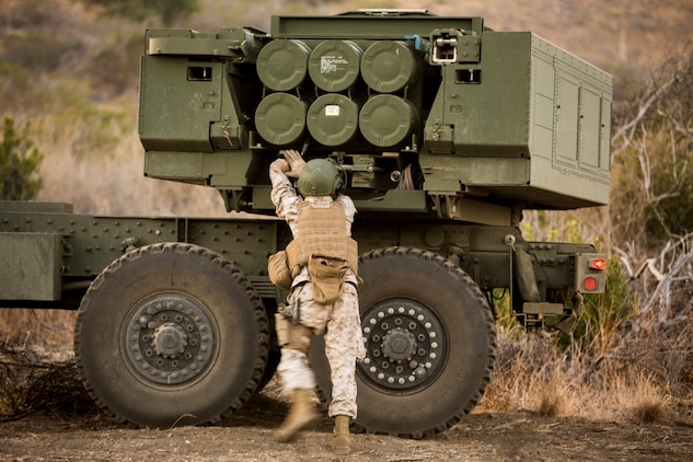 Sergeant John Matthieu, a High Mobility Artillery Rocket System operator with Battery Q, 5th Battalion, 11th Marine Regiment, inspects his HIMARS before a live-fire exercise aboard Marine Corps Base Camp Pendleton, Calif., Oct. 22, 2014. Conducting live-fire exercises strengthens the Marines' ability to fire effectively in future operations.