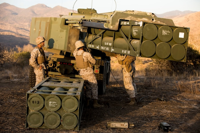 Marines with Battery Q, 5th Battalion, 11th Marine Regiment, navigate a missile pod into an M142 High Mobility Artillery Rocket System during a live-fire exercise aboard Marine Corps Base Camp Pendleton, Calif., Oct. 22, 2014. Conducting live-fire exercises strengthens the Marines' ability to fire effectively in future operations.