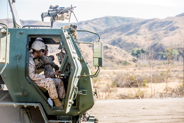 Marines with Battery Q, 5th Battalion, 11th Marine Regiment, enter coordinates into an M142 High Mobility Artillery Rocket System during a live-fire exercise aboard Marine Corps Base Camp Pendleton, Calif., Oct. 22, 2014. Conducting live-fire exercises strengthens the Marines' ability to fire effectively in future operations.