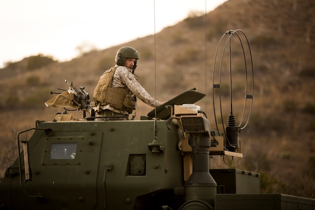 Sergeant John Matthieu, a High Mobility Artillery Rocket System operator with Battery Q, 5th Battalion, 11th Marine Regiment, supervises a rocket reload during a live-fire exercise aboard Marine Corps Base Camp Pendleton, Calif., Oct. 22, 2014. Conducting live-fire exercises strengthens the Marines' ability to fire effectively in future operations.