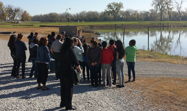 As part of the Hispanic Employment Council Role Model Project students from two Omaha, Neb. middle schools were educated on the use of tow boats and barges in the Missouri River basin by Alan Schmidt who explained how the crew uses the equpment on the river to maintain the navigation channel.