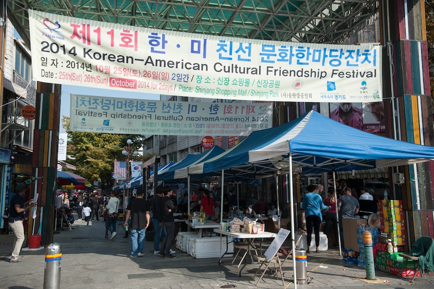 Food, merchandise and game booths line the streets during the 11th Korean American Friendship Cultural Festival at the Songtan Entertainment District, Republic of Korea, Oct.25, 2014. The festival is a two-day event designed to celebrate the long-standing friendship between the United States and ROK. (U.S. Air Force photo by Senior Airman Matthew Lancaster)