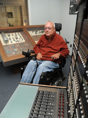 John Dockens, 81st Communications Squadron senior client systems technician, poses for a photo at the 81st CS among antique communications equipment, Oct. 20, 2014, Keesler Air Force Base, Miss. Dockens has been employed at Keesler for almost 20 years. (U.S. Air Force photo by Kemberly Groue)