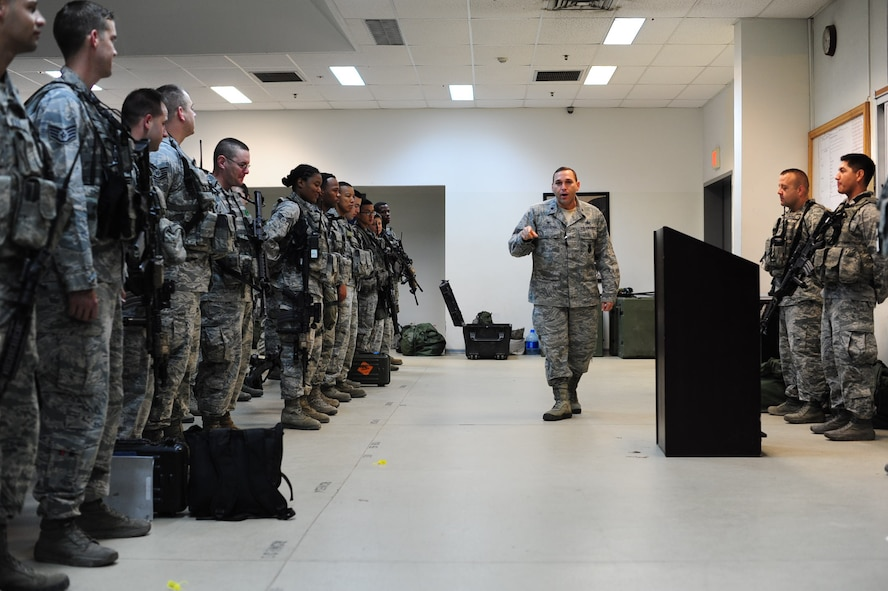 Lt. Col. Joseph Musacchia, 39th Security Forces Squadron commander, briefs defenders at guard mount, Oct. 21, 2014, Incirlik Air Base, Turkey. Musacchia took command of the 39th SFS March 14, 2013. (U.S. Air Force photo by Staff Sgt. Eboni Reams/Released)
