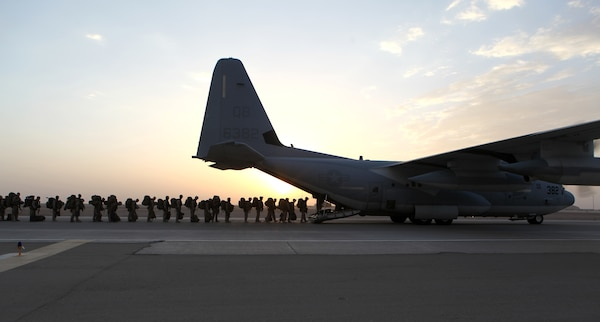 Marines and sailors with Marine Expeditionary Brigade Afghanistan load onto a KC-130 aircraft at Camp Bastion in Afghanistan's Helmand province, Oct. 27, 2014. The Marine Corps ended its mission in Helmand province the day prior. U.S. Marine Corps photo by Staff Sgt. John Jackson