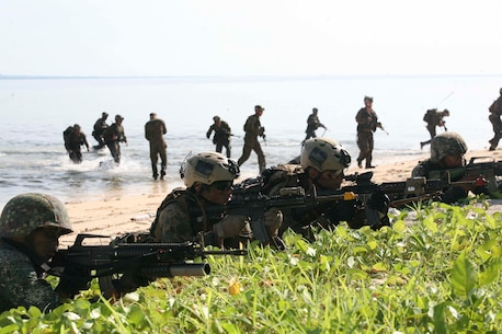 Philippine and U.S. Marines provide security while simulating a raid on a small island off the coast of Palawan, Philippines, Oct. 2 during Amphibious Landing Exercise 2015. The amphibious assault and boat raids were conducted by U.S. Marines to complete a certification exercise being held in conjunction with PHIBLEX 15. PHIBLEX is an annual, bilateral training exercise conducted by the Armed Forces of the Philippines, U.S. Marines and Navy to strengthen interoperability across a range of capabilities, including disaster relief and contingency operations. The AFP Marines are with 12th Marine Battalion, Philippine Marine Corps, and the U.S. Marines are with Battalion Landing Team 3rd Battalion, 5th Marine Regiment, 31st Marine Expeditionary Unit. (U.S. Marine Corps photo by Sgt. Anthony J. Kirby/Released)
