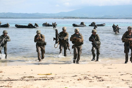 Philippine and U.S. Marines simulate an amphibious landing and beach assault on a small island off the coast of Palawan, Philippines, Oct. 2 during Amphibious Landing Exercise 2015. The amphibious assault and boat raids were conducted by U.S. Marines to complete a certification exercise being held in conjunction with PHIBLEX 15. PHIBLEX is an annual, bilateral training exercise conducted by the Armed Forces of the Philippines, U.S. Marines and Navy to strengthen interoperability across a range of capabilities, including disaster relief and contingency operations. The AFP Marines are with 12th Marine Battalion, Philippine Marine Corps, and the U.S. Marines are with Battalion Landing Team 3rd Battalion, 5th Marine Regiment, 31st Marine Expeditionary Unit. (U.S. Marine Corps photo by Sgt. Anthony J. Kirby/Released)
