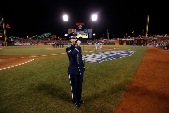 "Airman 1st Class Michelle Doolittle sings ""God Bless America"" Oct. 26, 2014, during the seventh-inning stretch of Game 5, of the 2014 World Series. She represented the Airmen from Travis Air Force Base, California and the Air Force at the game. Doolittle is an Air Force Band of the Golden West vocalist. (Courtesy photo)"