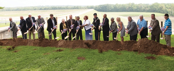 Federal, state and local officials take part in the groundbreaking ceremony for the Bolivar Dam seepage barrier.