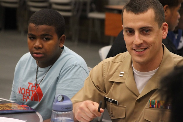 U.S. Marine Corps Capt. Scott Riley, the executive officer of Marine Corps Recruiting Station Raleigh and Raleigh, North Carolina, native, leads a class on Marine Corps leadership traits during a 100 Black Men of America, Inc., event at North Carolina State University, Oct. 18, 2014. 100 local high school and college students, all mentees of the 100 Black Men of America, Inc., Triangle East Chapter, participated in discussions with local Marines about leadership traits and principles. (U.S. Marine Corps photo by Sgt. Dwight A. Henderson/Released)