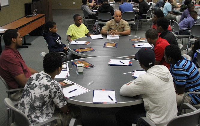 U.S. Marine Corps Sgt. Malcolm Love, a recruiter with Marine Corps Recruiting Station Raleigh and Burlington, North Carolina, native, leads a class on Marine Corps leadership principals during a 100 Black Men of America, Inc., event at North Carolina State University, Oct. 18, 2014. 100 local high school and college students, all mentees of the 100 Black Men of America, Inc., Triangle East Chapter, participated in discussions with local Marines about leadership traits and principles. (U.S. Marine Corps photo by Sgt. Dwight A. Henderson/Released)