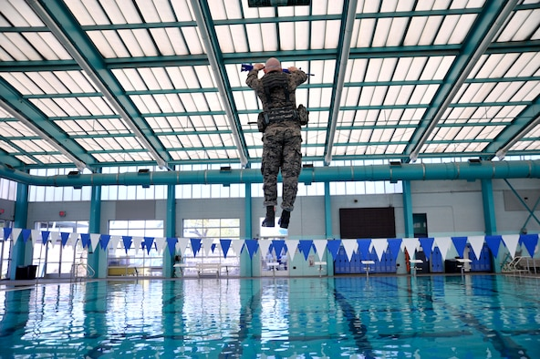 A Ranger Assessment Course student is pushed into a pool as part of the combat water survival portion of RAC, Oct. 2, 2014, in Las Vegas. Before entering the water, students wear blacked out goggles and are spun three times before being blindly pushed into the pool by an instructor. (U.S. Air Force photo/Airman 1st Class Christian Clausen)