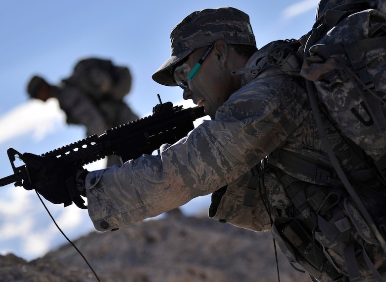 Senior Airman Franklin Sloat returns fire with blanks during a simulated enemy ambush during a foot patrol as part of the Ranger Assessment Course Oct. 8, 2014, at Silver Flag Alpha range, Nev. During the foot patrol the students are ambushed and must work as a team to successfully neutralize the threat and prevent friendly casualties. Sloat is a 791st Missile Security Forces Squadron member at Minot Air Force Base, N.D. (U.S. Air Force photo/Airman 1st Class Christian Clausen)