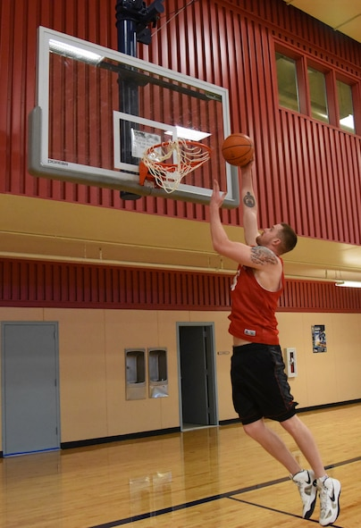 Senior Airman John Robertson, 741st Missile Security Forces Squadron convoy response force leader, performs a lay-up Oct. 17 at the Malmstrom Air Force Base fitness center. Robertson, 22, is one out of 22 Airmen selected to try out for the Air Force men's basketball team. (U.S. Air Force photo/Airman 1st Class Joshua Smoot)