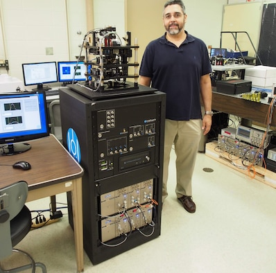 Dr. Jeffrey Yepez, researcher, Air Force Research Laboratory Directed Energy Directorate and leader of the joint AFRL and University of Hawaii Manoa quantum computing group received two new table-top quantum computing systems to trap and study the behavior of atoms in their condensed, pristine state.The new systems, delivered by cold-atom technology developer, ColdQuanta, provide researchers with a lower cost, in house opportunity to study the mysteries of quantum physics. (Air Force photo)