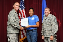 Fa'alupe Alford, 33rd Aircraft Maintenance Squadron commanders support staff, is presented the Air Education and Training Command 2014 National Image, Inc. Meritorious Service award from Col. Todd Canterbury, 33rd FW commander, and Chief Master Sgt. Scott Berge, 33rd FW command chief, on Eglin Air Force Base, Fla., Oct 17, 2014. Alford has been a community leader for both Navarre and Niceville, Fla. She has been an advocate from the 33rd FW honorary commander program and the key spouse programs at Eglin AFB and Hurlburt Field, Fla., which are vital to family readiness.  She has also been an avid supporter of the Air Force Enlisted Village and the Eglin AFB sexual assault prevention and response program. (U.S. Air Force photo/Staff Sgt. Marleah Robertson)