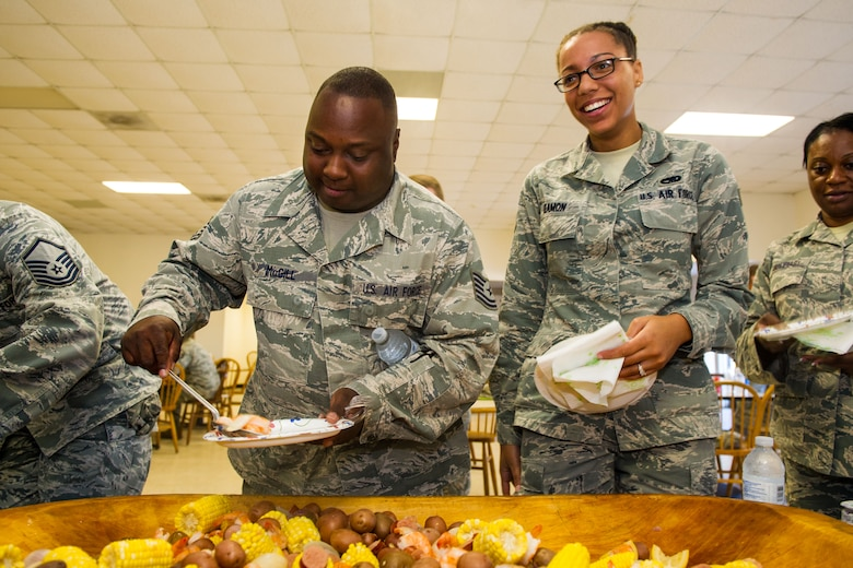 U.S. Airmen, assigned to the 169th Fighter Wing at McEntire Joint National Guard Base of the South Carolina Air National Guard, celebrate Diversity Day by eating a variety of ethnic foods and sharing cultural camaraderie, Oct. 4, 2014. Diversity Day combines the Department of Defense's monthly diversity programs into a one day event for guardsmen to learn about other cultures and to celebrate diversity. (U.S. Air National Guard by photo by Tech. Sgt. Jorge Intriago/Released)