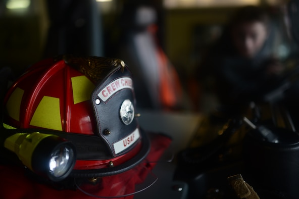 A firefighter's safety helmet rests inside a fire truck at Spangdahlem Air Base, Germany, Oct. 27, 2014. The tour included a look at the base's passenger terminal, a fire station and ended with photo opportunities at the air park. (U.S. Air Force photo by Senior Airman Gustavo Castillo/Released)
