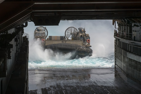 Landing Craft Air Cushion (LCAC) 47, assigned to Naval Beach Unit (NBU) 7, embarks the well deck of the amphibious dock landing ship USS Germantown (LSD 42) during Amphibious Landing Exercise 2015 (PHIBLEX15). PHIBLEX15 is an annual bilateral training exercise conducted with the Armed Forces of the Philippines. Germantown is part of the Peleliu Expeditionary Strike Group, commanded by Rear Adm. Hugh Wetherald, and is conducting joint forces exercises in the U.S. 7th Fleet area of responsibility.  (U.S. Navy Photo by Mass Communication Specialist 2nd Class Amanda R. Gray/Released)