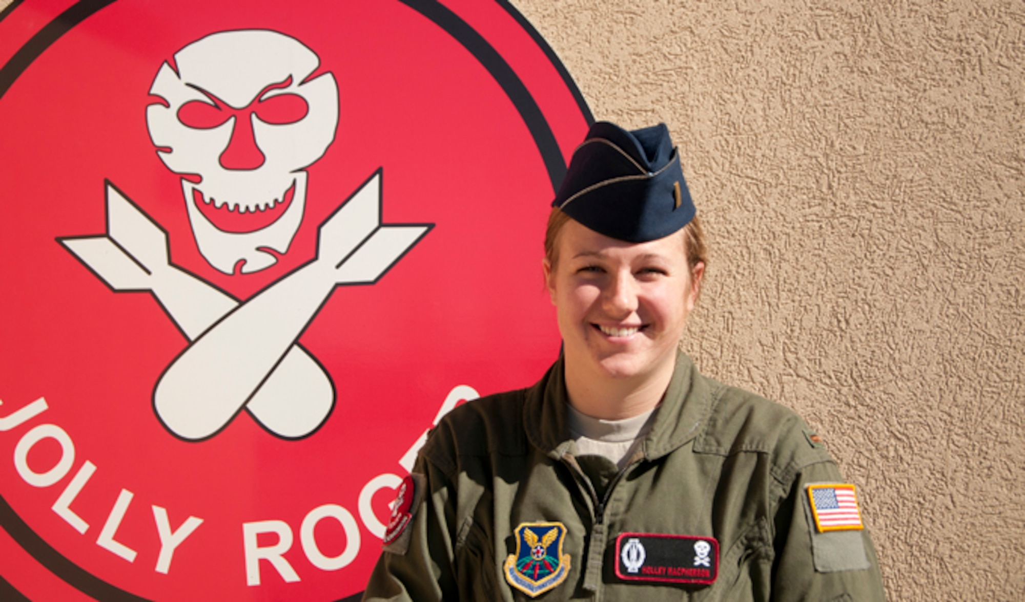 Second Lt. Holley Macpherson poses outside the 90th Operations Group Oct. 20, 2014 at F.W. Warren Air Force Base, Wyo. Recently, Macpherson pulled her first alert in a launch control center in the F.E. Warren AFB Missile Complex, where she and a crew commander monitored the ICBM mission in their flight area.320th Missile Squadron deputy missile combat crew commander. (U.S. Air Force photo/Senior Airman Jason Wiese)