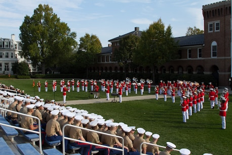 """""""The Commandant's Own,"""" The United States Marine Drum & Bugle Corps performs at Marine Barracks Washington, D.C., during a relief and appointment ceremony at the Barracks, Oct. 29, 2014. During the ceremony, Sgt. Maj. Joseph C. Gray took over responsibilities from Sgt. Maj. Angela M. Maness as the Barracks sergeant major."""