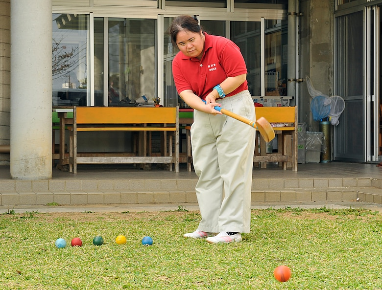 Yoshie Nakamura, welfare employment center employee, practices ground golf for her fourth Kadena Special Olympics at the Fuyo-Kan, welfare employment center, Oct. 28, 2014. Approximately 50 people will be participating in KSO from Fuyo-Kan, welfare employment center. (U.S. Air Force photo by Naoto Anazawa/Released)