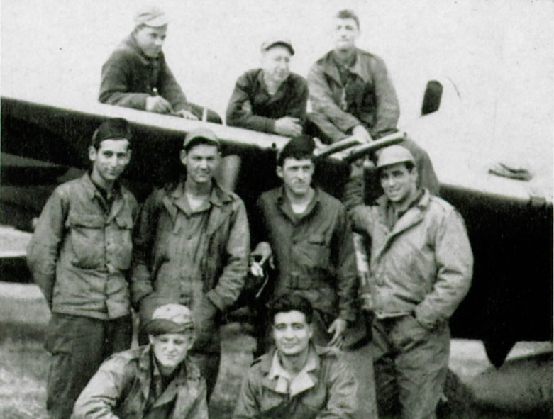 Armorers of the 405th Fighter Squadron such as Sergeant Louis P. Cellitti, third from the left atop the wing of this P-47, loaded relief supplies instead of bombs on the squadron's P-47 Thunderbolts in order to help the Lost Battalion.  The other men seen in this view are, on wing left to right, Ras Rogers and Earl M. Berkley.  Standing are Benjamin H. Deller, Dan M. Nall, Irving J. Gnehm and Earnest P. Toma.  Kneeling are Rudolph D. Jennings and Albert Martinez.  (The Story of the 371st Fighter Group in the E.T.O., page 126)